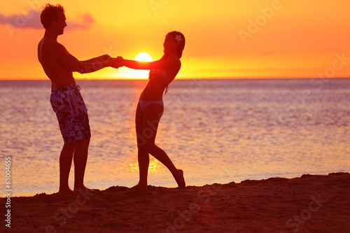 Romantic couple fun on beach sunset during travel