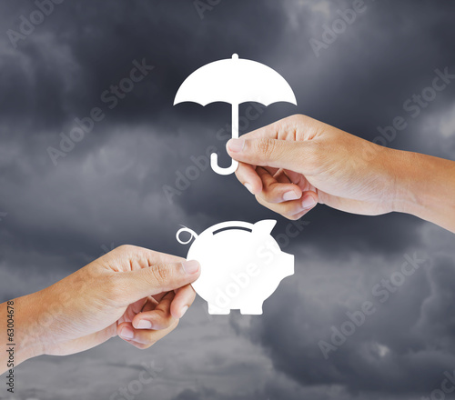 Hand holding a paper  piggy bank and umbrella, Insurance concept