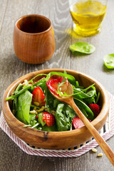 Light salad with spinach and strawberries.