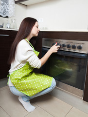 Girl  near the oven