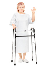 Female patient with walker waving with hand