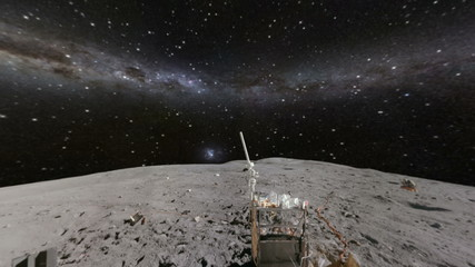 Surface of moon and glowing Milky Way and stars
