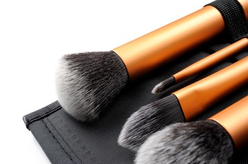 cosmetic brushes on white background