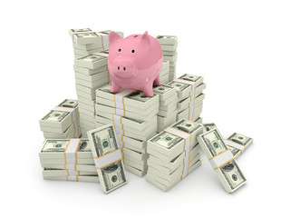 Piggy bank on top of pile of dollars