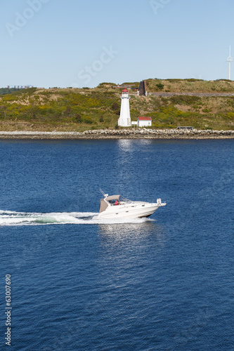White Yacht Past Lighthouse