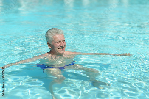 Senior man in pool