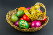 Decorated Easter eggs in a woven basket