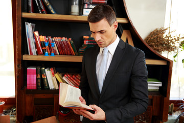 Businessman reading the book