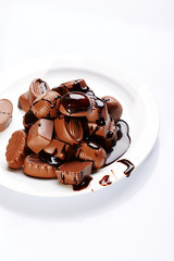 Chocolate candies over white background