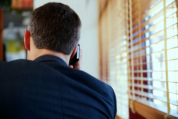 businessman talking on the phone at office