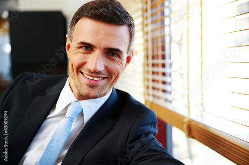 Portrait of a handsome happy businessman in suit