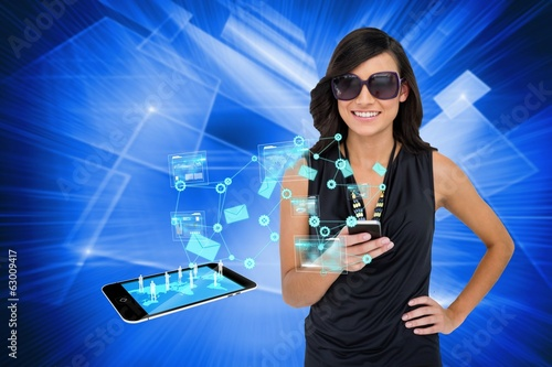 Glamorous brunette using smartphone with email symbols