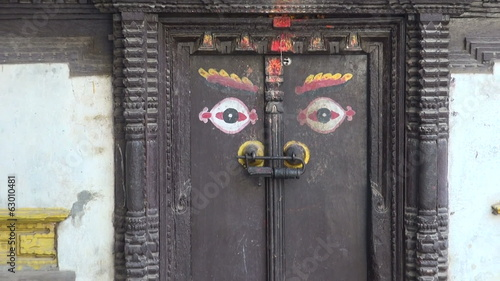 ornamental ancient door with Buddha eyes in Katmandu, Nepal