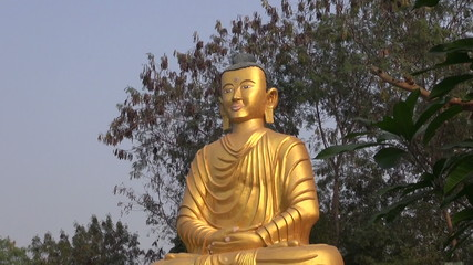 golden big  lord Buddha statue in Lumbini, Nepal
