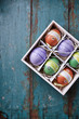 Colorful Easter Eggs on a Shabby Wooden Background