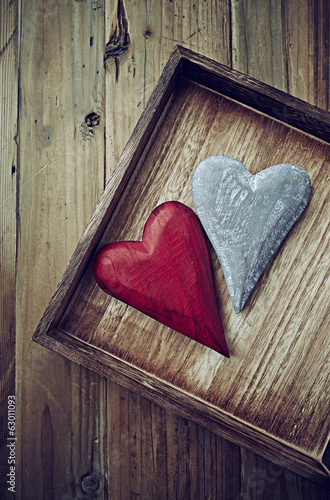 Two Wooden Hearts on a Rustic Tray
