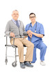 Male doctor and a man in wheelchair posing