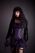 Gothic girl in purple and black outfit