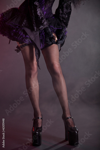 Gothic girl putting on stockings