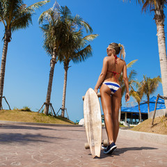 sexy woman and  longboard