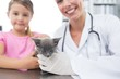 Veterinary and girl with kitten in hospital