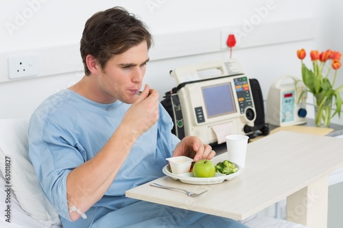 Man having healthy food in hospital