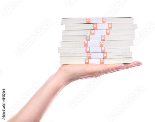 big packs of dollars in hand isolated on a white background