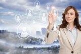 Smiling businesswoman pointing to profile picture