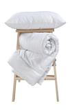 pillow and folded blanket on stepladder