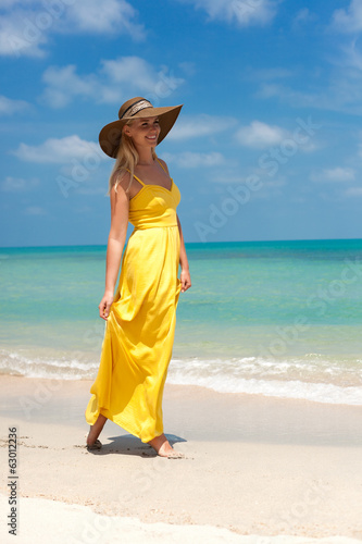 Young beautiful sexy blonde woman standing on beach