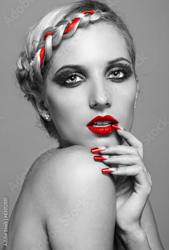 Young woman with red nails
