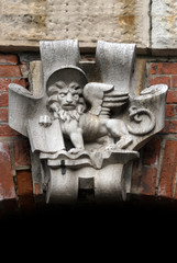Venetian Crest at the facade in Venice