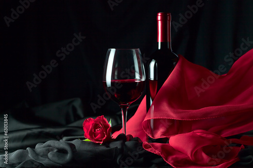 bottle and glass with red
