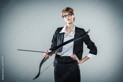 Business woman holding a bow and arrow