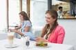 Woman using digital tablet in coffee shop