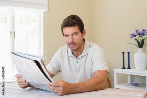 Portrait of a man reading newspaper