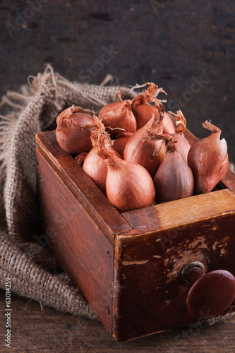 Shallots in an old wooden box