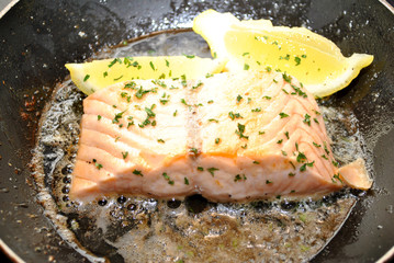 Fresh Salmon Cooking in Butter with Lemon