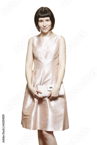 Bridesmaid wearing pink dress smiling