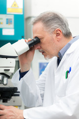 Man using a microscope in a laboratory