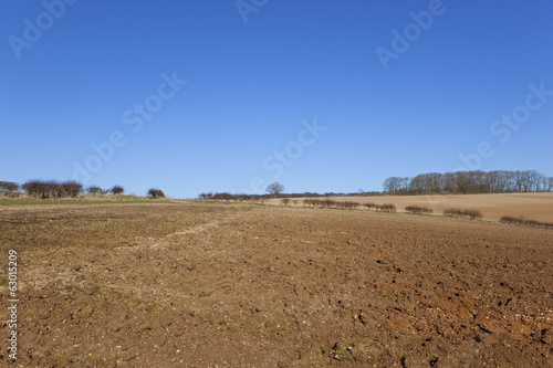 plow soil and blue sky