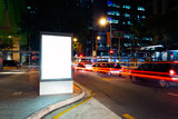 Fototapety Advertising light boxes in the city at night
