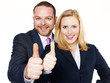 Successful business people show thumbs up