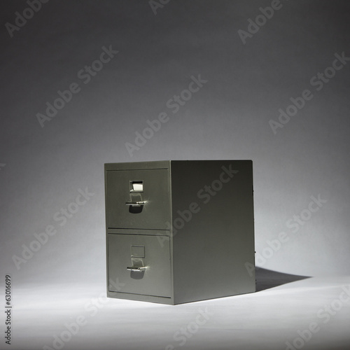 Grey Filing Cabinet in a Spotlight