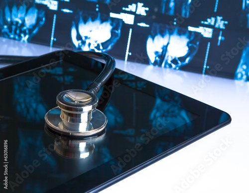 stethoscope on digital tablet in laboratory on x-ray image