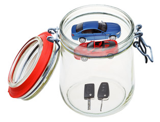 new cars and keys in glass jar