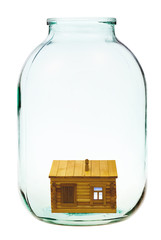 rural wooden house in big glass jar