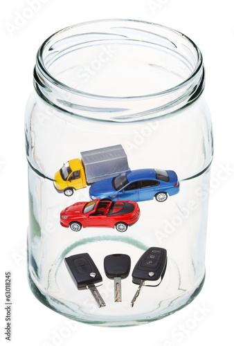 cars and keys in open glass jar