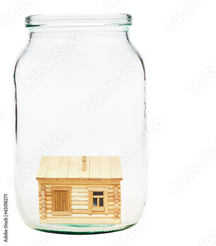 wooden village house in glass jar