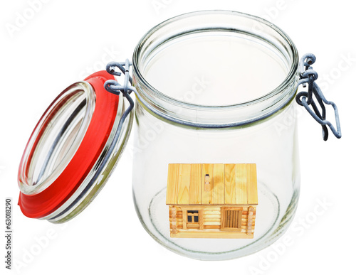 wooden house in glass jar